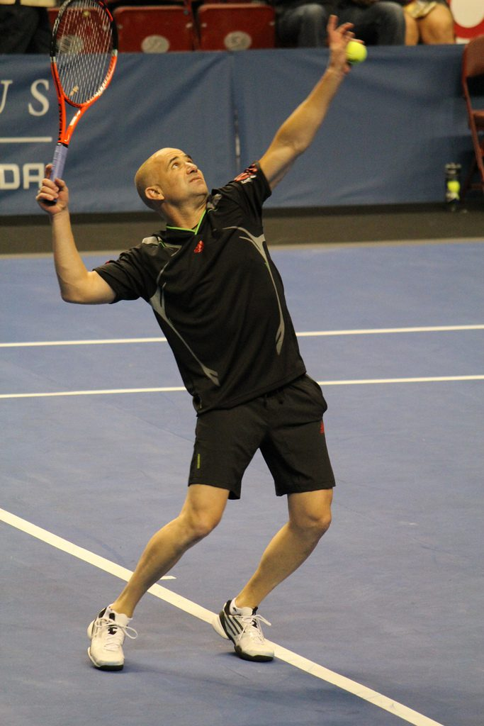 Agassi playing tennis